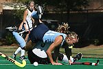 25 October 2014: North Carolina's Casey Di Nardo (21) earned a green card for this foul on Wake Forest's Georgia Holland (9). The University of North Carolina Tar Heels hosted the Wake Forest University Demon Deacons at Francis E. Henry Stadium in Chapel Hill, North Carolina in a 2014 NCAA Division I Field Hockey match. UNC won the game 3-1.