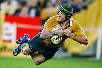 Australian rugby player Matt Giteau scores a try against Wales in Sydney.Picture James Horan