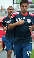 August 21 2010 New York Red Bulls forward Thierry Henry #14 warms up behind New York Red Bulls defender Carlos Mendes #44 during a game between the New York Red Bulls and Toronto FC at BMO Field in Toronto..The New York Red Bulls won 4-1.