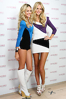Candice Swanepoel and Erin Heatherton pose together during the &quot;Incredible by Victoria's Secret&quot; launch at the Victoria Secret SOHO Store, August 10, 2010.