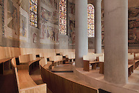Pews, frescoes and stained glass windows of the ambulatory in the absid of Nanterre Cathedral (Cathédrale Sainte-Geneviève-et-Saint-Maurice de Nanterre), 1924 - 1937, by architects Georges Pradelle and Yves-Marie Froidevaux, Nanterre, Hauts-de-Seine, France. Picture by Manuel Cohen