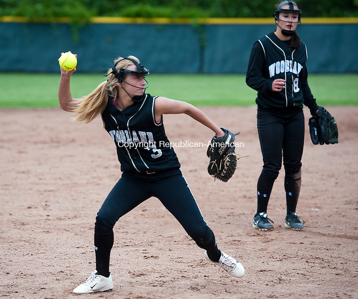 WOLCOTT, CT-052814JS11--Woodland's Stephanie Kiley  (3) throws to first for the out after fielding a ground ball during their NVL softball semi-final game against Seymour Wednesday at Wolcott High School. <br /> Jim Shannon Republican-American