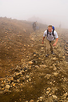 Hiker in cloudy weather on Tongariro Crossing, New Zealand