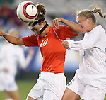 3 November 2006: Clemson's Nuria Zufia (10) heads the ball in front of North Carolina's Ali Hawkins (right). North Carolina defeated Clemson 3-0 at SAS Soccer Park in Cary, North Carolina in an Atlantic Coast Conference women's college soccer tournament semifinal game.