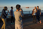 A group of Indonesian foreign students, going to college in Port Angeles, pose for portraits on the P.A. pier.