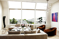 The huge picture windows, with their panoramic views over the Jardins du Luxembourg are the main feature of the spacious living room