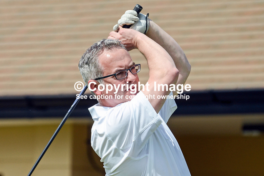 N Ireland Assembly minister, Alex Attwood, drives from the first tee. Photo taken 27th June 2012 on the first tee, Pro-Am competition, Irish Open Championship, Royal Portrush Golf Club, N Ireland. 201206270431..&copy; Victor Patterson, 54 Dorchester Park, Belfast, N Ireland. Tel: +44 2890661296; Mobile: +44 7802 353836; Emails: victorpatterson@me.com &amp; victorpatterson@gmail.com; www.victorpatterson.com