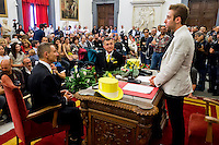Roma 21 Maggio 2015<br /> Celebration Day, l&rsquo;inaugurazione del registro delle unioni civili in Campidoglio. Sono 17 le coppie che si sono presentate per l&rsquo;iscrizione: coppie omosessuali ed eterosessuali che dopo anni di convivenza  festeggiano con lo scambio degli anelli, la cerimonia si &egrave; svolta nella sala della Protomoteca di Palazzo Senatorio.<br /> Rome May 21, 2015<br /> Celebration Day, the opening of the register of civil unions in the Capitol. Are 17 couples that have occurred for registration: homosexual and heterosexual couples who, after years of living together celebrate with the exchange of rings, the ceremony was held in the hall of Protomoteca Palazzo Senatorio.Gay couple Angelo Albanesi and Giorgio De Simoni during the ceremony  for registered their civil union at Rome's city hall