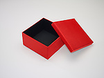 Open red gift box and lid with black lining