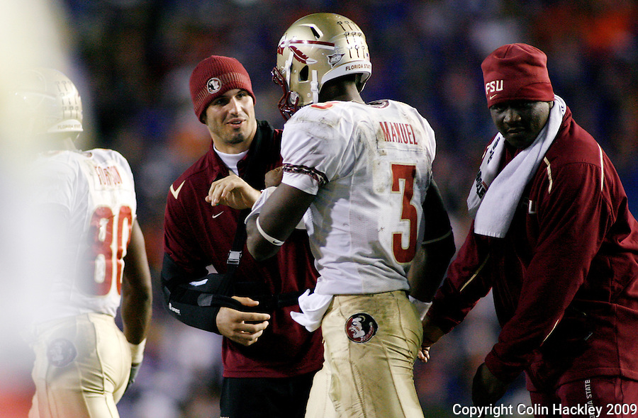 GAINESVILLE, FL 11/28/09-FSU-UF FB09 CH45-Florida State's Christian Ponder, left, congratulates EJ Manuel after a touchdown against Florida during second half action Saturday at Florida Field in Gainesville. The Gators beat the Seminoles 37-10..COLIN HACKLEY PHOTO