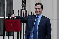 George Osborne, Chancellor of the Exchequer - 2012<br /> <br /> London, 21/03/2012. UK Chancellor of the Exchequer, George Osborne, who (followed by his team) shows the &quot;red box&quot; (Budget Box) containing the Budget for the fiscal year 2012. Previously, around 10:15 AM, Maria Gallastegiu from the &quot;Peace Strike group&quot; camped in Parliament Square, delivered a letter to the Prime Minister David Cameron at 10 Downing Street.