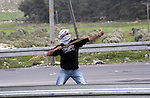 A Palestinian protester hurls stones at Israeli security forces during clashes near Huwwara checkpoint, near the West Bank city of Nablus, 28 February 2013. Hunger strikes by Palestinians in Israeli prisons have sparked clashes throughout the West Bank. On 23 February, a Palestinian detained for hurling a rock that injured an Israeli died in custody, further fuelling Palestinian anger. Palestinian hunger striker Samer Issawi has been transferred from an Israeli prison clinic to a civilian hospital near Tel Aviv, amid concerns that his health was deteriorating, according to reports 28 February. Photo by Nedal Eshtayah