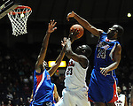 Ole Miss' Reginald Buckner (23) vs. SMU's Shawn Williams (2) and SMU's Robert Nyakundi (24) at the C.M. &quot;Tad&quot; Smith Coliseum in Oxford, Miss. on Tuesday, January 3, 2012. Ole Miss won 50-48.