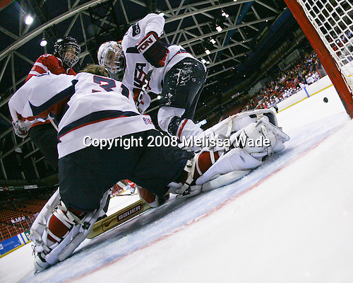 Caroline Ouellette (Canada - 13), Jessie Vetter (US - 31), Natalie Darwitz (US - 20) - Team USA defeated Team Canada 4-3 (so) to win the 2008 Four Nations Cup on Sunday, November 9, 2008, in the 1980 Rink in Lake Placid, New York.