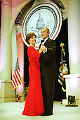 United States President George W. Bush and first lady Laura Bush dance at one of nine inaugural balls in Washington, D.C. on January 20, 2001..Credit: Robert Trippett / Pool via CNP.