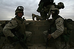 US Marines with Fox Co. 2nd Battalion 1st Marines make their way from rooftop to rooftop as they clear buildings looking for insurgents during the pre-dawn hours on the fourth day of Operation Steel Curtain, an operation to clear Husaybah (a city on the Iraq-Syrian border) of insurgents on Tues. Nov. 8, 2005.