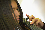A student plays a cello during music class in the Lydia Paterson Institute in El Paso, Texas. Most of the school's students travel across the border every day from their homes in Juarez, Mexico, to study at the United Methodist-sponsored high school.