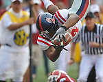 Ole Miss running back Brandon Bolden (34) is tackled by Arkansas safety Rudell Crim (4) at Reynolds Razorback Stadium in Fayetteville, Ark. on Saturday, October 23, 2010.