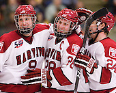 Danny Biega (Harvard - 9), Chris Huxley (Harvard - 28) and Luke Greiner (Harvard - 24) celebrate Biega's third (EN) goal. - The Harvard University Crimson defeated the visiting Colgate University Raiders 6-2 (2 EN) on Friday, January 28, 2011, at Bright Hockey Center in Cambridge, Massachusetts.