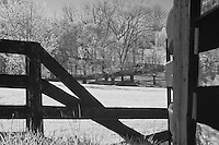 Rural Kentucky broken four plank fence showing bridge in the background.  Infrared (IR) photograph by fine art photographer Michael Kloth.