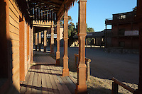 Western street set with wooden colonnade along shopfronts, at Fort Bravo / Texas Hollywood, a Western style theme park and film studios near Tabernas in the Tabernas Desert, Almeria, Andalusia, Southern Spain. Fort Bravo was set up in the 1970s by stuntman Rafa Molina and has a Texan Western set and Spanish Mexican pueblo, which can be used for locations or explored by tourists. Picture by Manuel Cohen