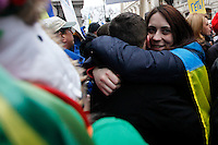 A couple hug while Ukrainian immigrants take part in a protest against war in front of the Russia consulate in New York. March 2, 2014. Photo by Eduardo Munoz Alvarez/VIEWpress