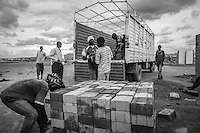 Kakuma, Kenya: Workers unload ISSBs (Interlocking Stabilized Soil Bricks) that will be used to construct more permanent homes for Somali refugees who have been pre-approved for resettlement in the United States.