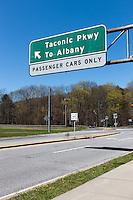 A sign pointing to the entrance to the southern end of the Taconic State Parkway.  The parkway begins at the Kensico Dam in Valhalla in Westchester County and runs north for 104 miles to Chatham in Columbia County, New York
