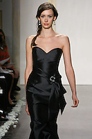 Model walks runway in a black mikado trumpet gown, strapless sweetheart neckline bridesmaid dress by Lazaro Perez, from the Noir by Lazaro Spring 2012 Bridal fashion show.