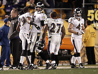 PITTSBURGH, PA - NOVEMBER 06: Joe Flacco #5 of the Baltimore Ravens celebrates with teammates Ray Rice #27 and Cary Williams #29 after throwing the game winning touchdown against the Pittsburgh Steelers during the game on November 6, 2011 at Heinz Field in Pittsburgh, Pennsylvania.  (Photo by Jared Wickerham/Getty Images)