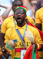 A Ghana supporter cheers his side on