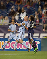 Colorado Rapids forward Conor Casey (9) chest traps as New England Revolution defender Kevin Alston (30) defends. The Colorado Rapids defeated the New England Revolution, 2-1, at Gillette Stadium on April 24, 2010.