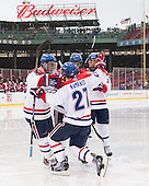 Terrence Wallin (UML - 9), Zack Kamrass (UML - 27), Joseph Pendenza (UML - 14), Michael Kapla (UML - 3) - The Northeastern University Huskies defeated the University of Massachusetts Lowell River Hawks 4-1 (EN) on Saturday, January 11, 2014, at Fenway Park in Boston, Massachusetts.
