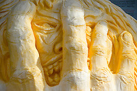 Face in hands, carved pumpkin art, Damariscotta Maine USA