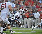 Alabama running back Eddie Lacy (42) is tackled by Ole Miss' Aaron Garbutt (20) at Vaught-Hemingway Stadium in Oxford, Miss. on Saturday, October 14, 2011. Alabama won 52-7.