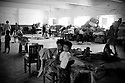 Different families sleep together in a school building in Kamari town. All over Pakistan schools, colleges and other government buildings are being used as temporary shelter for flood affected families. Hygiene is one of the biggest concerns and most people have skin infections, diarhhea and other diseases. Karachi, Pakistan, 2010