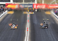 Feb 26, 2017; Chandler, AZ, USA; NHRA top fuel driver Clay Millican (left) races alongside Troy Buff during the Arizona Nationals at Wild Horse Pass Motorsports Park. Mandatory Credit: Mark J. Rebilas-USA TODAY Sports