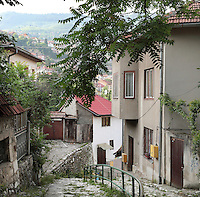 Steep narrow street with houses in the old town of Sarajevo, Bosnia and Herzegovina. Founded by the Ottomans in 1461, the city sits in the Sarajevo Valley surrounded by the Dinaric Alps. Picture by Manuel Cohen