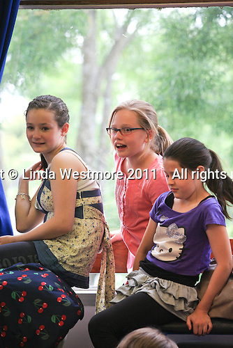 """Cast members watching others.  The Yvonne Arnaud Youth Theatre rehearsing """"The Lion, the Witch and the Wardrobe"""", Guildford, Surrey."""