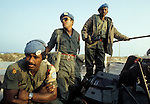 Member of the Fijian contingent of UNIFIL ride in a transport northwasrd toward Beirut and the flight returning them home to their Pacific islands.