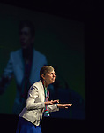 Harriett Olson, the top executive of united Methodist Women, speaks during an April 27, 2014, worship service at the United Methodist Women's Assembly in the Kentucky International Convention Center in Louisville, Kentucky. More than 6,500 members of United Methodist Women gathered for the quadrennial event.