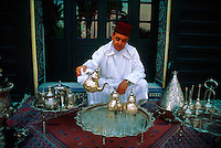 Moroccan man serving mint tea at the &quot;Al Fassia&quot; restaurant in the Palais Jamai, Fes, Morocco
