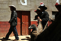 A wild condor is held by its wings as it is paraded around the village during the Yawar Fiesta in Coyllurqui in the Peruvian Andes on Independence Day. This celebration symbolises the clash between the indigenous people (represented by the condor) and the Spanish (represented by a bull). The condor is paraded around town, strapped on top of the bull, given alcohol, and finally set free.