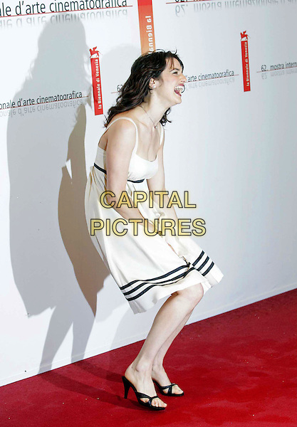 """RACHEL WEISZ.""""The Constant Gardener"""" premieres at the 62nd Annual Venice Film Festival, Venice, Italy..September 9th, 2005.Photo Credit: Bedrosien/Siemoenit/Admedia.full length white dress stripes windy laughing .www.capitalpictures.com.sales@capitalpictures.com.© Capital Pictures."""