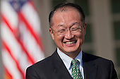 Jim Yong Kim, president of Dartmouth College, laughs as he is introduced by United States President Barack Obama, not pictured, as a nominee to become president of the World Bank in the Rose Garden of the White House in Washington, D.C., U.S., on Friday, March 23, 2012. Kim was born in Seoul and is a U.S. citizen. He would succeed Robert Zoellick as the head of the bank. The bank made $57 billion loans in the last fiscal year. .Credit: Andrew Harrer / Pool via CNP