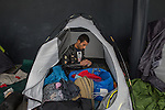 A father of two from Afghanistan packs up the family's belongings inside a tent at a makeshift camp in the Budapest Keleti railway station. The family wants to settle in Sweden.<br /> <br /> Hundreds of refugees from mostly Syria and Afghanistan gather at the Budapest Keleti railway station waiting for trains to leave for destinations such as Austria, Germany and Sweden, in Budapest, Hungary, on Tuesday, Sept. 8, 2015. Hungary's Prime Minister Viktor Orban created an anti-refugee campaign to generate hate against those fleeing war in their home countries. The country is currently 50% xenophobic and the government has become increasingly authoritarian.