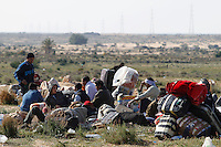Thousands of people, mainly Egyptian workers, flee unrest in Libya and cross the border into Tunisia. Some slept in the open for several days before being processed. .At the same time forces loyal to Col. Gaddafi fought opposition forces in various parts of the country.