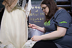 Graduate student Megan Rogers works on recreating a 1910s-era gown at the Student Expo on April 6, 2017.