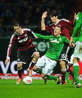 FUSSBALL   1. BUNDESLIGA    SAISON 2012/2013    17. Spieltag   SV Werder Bremen - 1. FC Nuernberg                     16.12.2012 Markus Feulner (li) und Timm Klose (re, beide 1. FC Nuernberg) gegen Lukas Schmitz (Mitte, SV Werder Bremen)