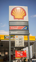 Gas prices at a Shell station in New York are seen on Saturday, October 18, 2014. The national average price for gasoline fell 6.1 cents per gallon to $3.12 while New York State's average  fell 3.1 cents per gallon last week, to $3.47.  (© Richard B. Levine)